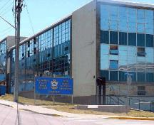General view of the Trades Training Building, showing the use of durable, easy to maintain materials including glass, concrete block, reinforced concrete, and steel, 2005; CFB Esquimalt / BFC Esquimalt, 2005.