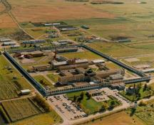 Aerial view of the Prince Albert Penitentiary, showing the Southern Tower D-2 on the far left of the image, 1990.; Correctional Service Canada / Service correctionnel Canada, 1990.
