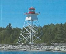 General view of Rear Range Light Tower, showing the use of contrasting white and red colors and of the day mark, which increase the structure's daytime visibility.; Fisheries and Oceans Canada / Pêches et Océans Canada.