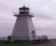 General view of Baccaro Point Lighthouse, showing its simple square, tapered profile and good proportions, 2004.; Parks Canada Agency/Agence Parcs Canada, 2004.