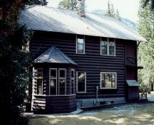 Rear view of the Superintendent's Residence, showing its two-storey structure with a one-storey frame bay addition on the rear, 1992.; Parks Canada Agency / Agence Parcs Canada, 1992.