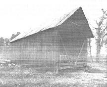 General view of the Hay Shed, showing the east and south façades, 1992.; Department of Public Works, AES, PC, WRO / Ministère des Travaux publics, SAG, PC, BRO, 1992.