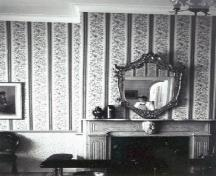 Interior view of Building 1, showing the original fireplace and the woodwork and detailing including classical elements such as the door casings, mouldings and early mantelpieces, 1991.; Parks Canada Agency / Agence Parcs Canada, Ian Doull, 1991.