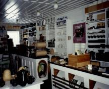 View of the interior of the St. Laurent Store and Warehouse, showing the built-in furnishings and all the other elements that evoke the former commercial use of the building, 1993.; Parks Canada Agency / Agence Parcs Canada, 1993.