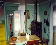View of the kitchen of Wilfrid Laurier House, showing the elements of the interior that contribute to the idealized vision of a late 19th-century middle-class vernacular house at the time of restoration, 1992.; Parks Canada Agency / Agence Parcs Canada, 1992.