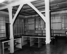 Interior view of the Ryan Retail Store, showing the shelves and counters in the sales area of the Retail store, 1991.; Agence Parcs Canada / Parks Canada Agency, 1991.