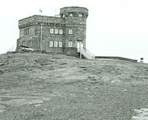 General view of Cabot Tower, showing its two-storey 9.4-metre (30-foot) square structure and three-storey 15.24-metre (50-foot) octagonal tower, 1988.; Parks Canada Agency / Agence Parcs Canada, I. Doull , 1988.