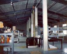 General view of the Warehouse and Office, showing its open, well-lit interior, 1990.; Parks Canada Agency / Agence Parcs Canada, 1990.