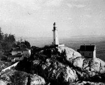Historical photograph of the Light Tower at Point Atkinson, showing its compatibility with its wilderness seascape setting, 1925.; Parks Canada Agency / Agence Parcs Canada, 1925