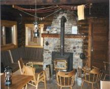 Interior of the Stanley Mitchell Alpine Hut, demonstrating the rustic design of the building, 1998.; Parks Canada Agency\Agence Parcs Canada, 1998.
