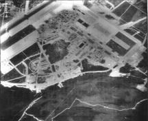 View of the Royal Canadian Air Force Base at Goose Bay, showing Hangar 8 at the top of the image, 1955.; Natural Resources Canada / Ressources naturelles Canada, Photo Library, A14865-41, 1955.