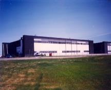 View of the Royal Canadian Air Force Hangar 8, showing the high sliding interlocking doors, 1998.; Department of National Defence / Ministère de la Défense nationale, 1998.