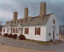 General view of the Officers' Quarters, showing its storey-and-a-half, gambrel-roofed, rectangular structure with a regularized plan, 1982.; (Canadian Parks Service, Atlantic Regional Office / Service canadien des parcs, Bureau régional de l'Atlantique, 1982.)