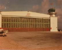 View of the west elevation of the Air Terminal Building (H-7), showing the six large panels of horizontally sliding glazed hangar doors.; Transport Canada / Transports Canada
