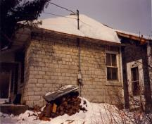 General view of the right façade of the Defensible Lockmaster's House, 1987.; Parks Canada Agency / Agence Parcs Canada, 1987.