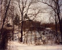 General view of the left façade of the Defensible Lockmaster's House, 1987.; Parks Canada Agency / Agence Parcs Canada, 1987.