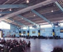 Interior view of the Drill Hall, showing the large central training space, 2003.; Department of National Defence / Ministère de la Défense nationale, 2003.