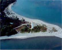 Aerial view of the Tower at Christian Island, showing its prominent position on a peninsula, 1990.; Canadian Coast Guard / Garde côtière canadienne, 1990.