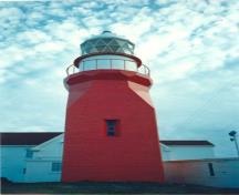 General view of the Lighthouse, showing the sequential geometric massing of the tower, 1988.; Canadian Coast Guard / Garde côtière canadienne, 1988.