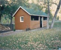 General view of Kitchen Shelter 9, showing the four-foot high walls, 1990.; Parks Canada Agency / Agence Parcs Canada, 1990.