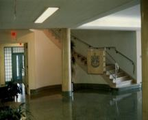 Interior view of Building M-20, showing the interior spatial arrangement of the main lobby, 1990.; National Research Council of Canada / Conseil national de recherches du Canada, 1990.