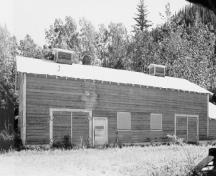 View of the Gas House, showing the large double doors with horseshoe hinges, 1988.; Parks Canada Agency / Agence Parcs Canada, 1988.