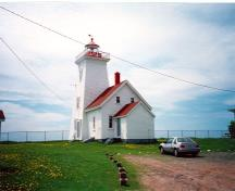 Rear view of the Tower and Fog Alarm at Wood Islands, showing the metal and glass lantern, the wood frame construction, and multi-pane wood sash windows, ca. 1990.; Department of Transport / Ministère des Transports, ca./vers 1990.
