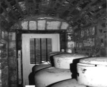 View of a storage room of Building 30, showing its vaulted interior, 1991.; Parks Canada Agency / Agence Parcs Canada, Rhona Goodspeed, 1991.