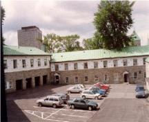 View of Building 1, showing the two-storey massing with a sheet copper shed roof, 1993.; Agence Parcs Canada / Parks Canada Agency, 1993.