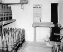 Interior view of the Gun Emplacement, Magazine and Crew Shelter 1, showing the explosives and shell stores chambers, c. 1945.; Department of National Defence / Ministère de la Défense nationale.