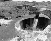 View of the Gun Emplacement, Magazine and Crew Shelter 1, showing the gun platform and issuing hatches, 1996.; Agence Parcs Canada / Parks Canada Agency, 1996.