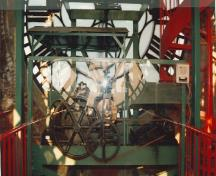 View from inside the Clock Tower of one of the clock faces and its mechanisms, 1996.; Parks Canada Agency / Agence Parcs Canada, Christiane Lefebvre, 1996.