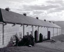 General view of the Commissariat Stores / Reverse Fire Chamber West, showing the simple, plain geometric massing of the solidly built ashlar faced rectangular building, 1996.; Parks Canada Agency / Agence Parcs Canada, Graham, October 1996.