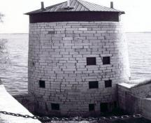 General view of Branch Tower East, showing the simple geometric massing of the massive ashlar faced circular tower, 1996.; (Graham, October 1996.)