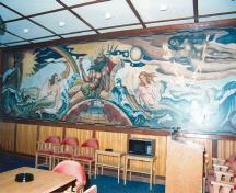 Interior view of Building 30, showing the large mural, 1992.; Department of National Defence / Ministère de la Défense nationale, 1992.