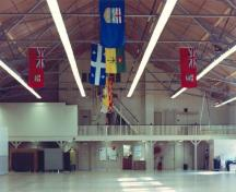 Interior view of the Armoury in Pembroke, showing its large, open drill hall with its exposed steel trusses, 1992.; Department of National Defence / Ministère de la Défense nationale, 1992.