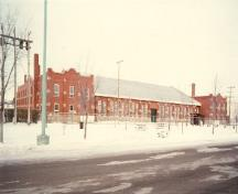 Rear view of the D.V. Currie VC Armoury, showing its economical, but high-quality design and construction, with careful attention to detailing and selection of materials, 1986.; Parks Canada Agency / Agence Parcs Canada, 1986.
