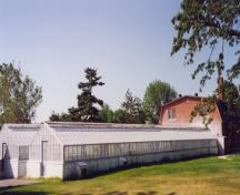 View of the rear of the Cereal Crops Building, showing the greenhouses of modest scale and simple construction, 1995.; Parks Canada Agency / Agence Parcs Canada, 1995.