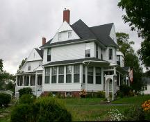 This image presents the building's picturesque qualities of the Queen Anne Revival style in a residential application.; PNB 2005
