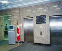 Interior view of the Administration Building, showing the marble walls and floor in the main lobby, 1998.; Parks Canada Agency/  Agence Parcs Canada, J. Mattie, 1998.