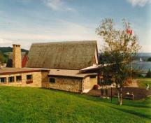 Exterior view of the side elevation of the Alexander Graham Bell Museum, showing the library and main gallery, 1996.; Parks Canada Agency / Agence Parcs Canada, 1996.
