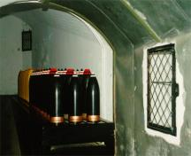 Interior of Magazine of the Lower Battery showing the left side of the shell storage area, 1997; Agence Parcs Canada / Parks Canada Agency, J. Mattie, 1997.