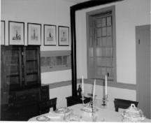 View of the interior of the Officers' Quarters, showing the dining room and office.; Agence Parcs Canada / Parks Canada Agency