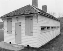 View of the Officers' Quarters, showing the small, loophole-style windows.; Agence Parcs Canada / Parks Canada Agency