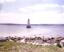 General view of the Sandy Point Lighthouse, June 2000.; Public Works and Government Services Canada / Travaux publics et Services gouvernementaux Canada, 2000.