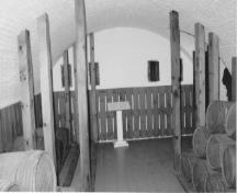 Interior view of the Blockhouse, showing the powder magazine with thick arched ceilings arched with brick, 1991.; Parks Canada Agency / Agence Parcs Canada, 1991.