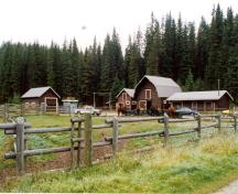Panorama looking north-west showing the pasture and the four operations buildings at Yoho Ranch, including the Horse barn (second building from the right), 1999.; Cultural Resource Services, Calgary, 1999.