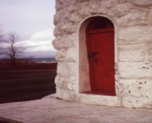 Detail of Point Clark lighthouse showing the round-headed doorway at its base, 1972.; Parks Canada Agency / Agence Parcs Canada, 1972