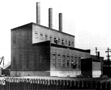 General view of the Ottawa Electric Railway Company Steam Plant from the northwest, showing the stepped massing, which is composed of a one-storey and two-storey block with a small addition to the west, 1958.; COA, OER Collection, CA-15021, 1958.