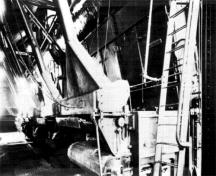 Interior view of the Ottawa Electric Railway Company Steam Plant, showing the former automatic stokers and boilers in the boiler room.; COA, OER Collection, CA-15030